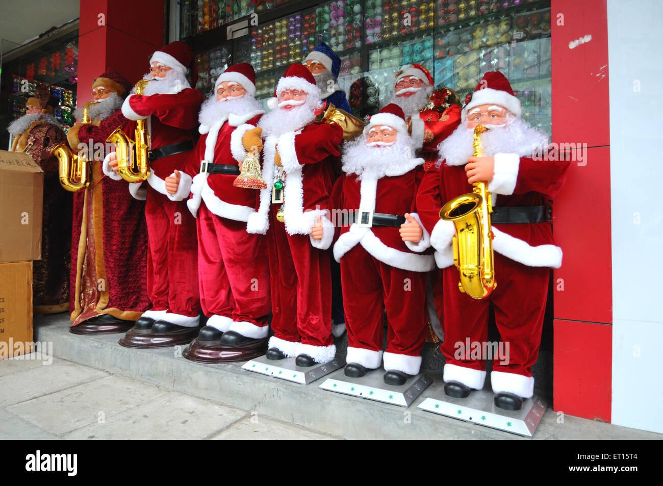 Santa Claus display Christmas shop window Beijing China - Stock Image