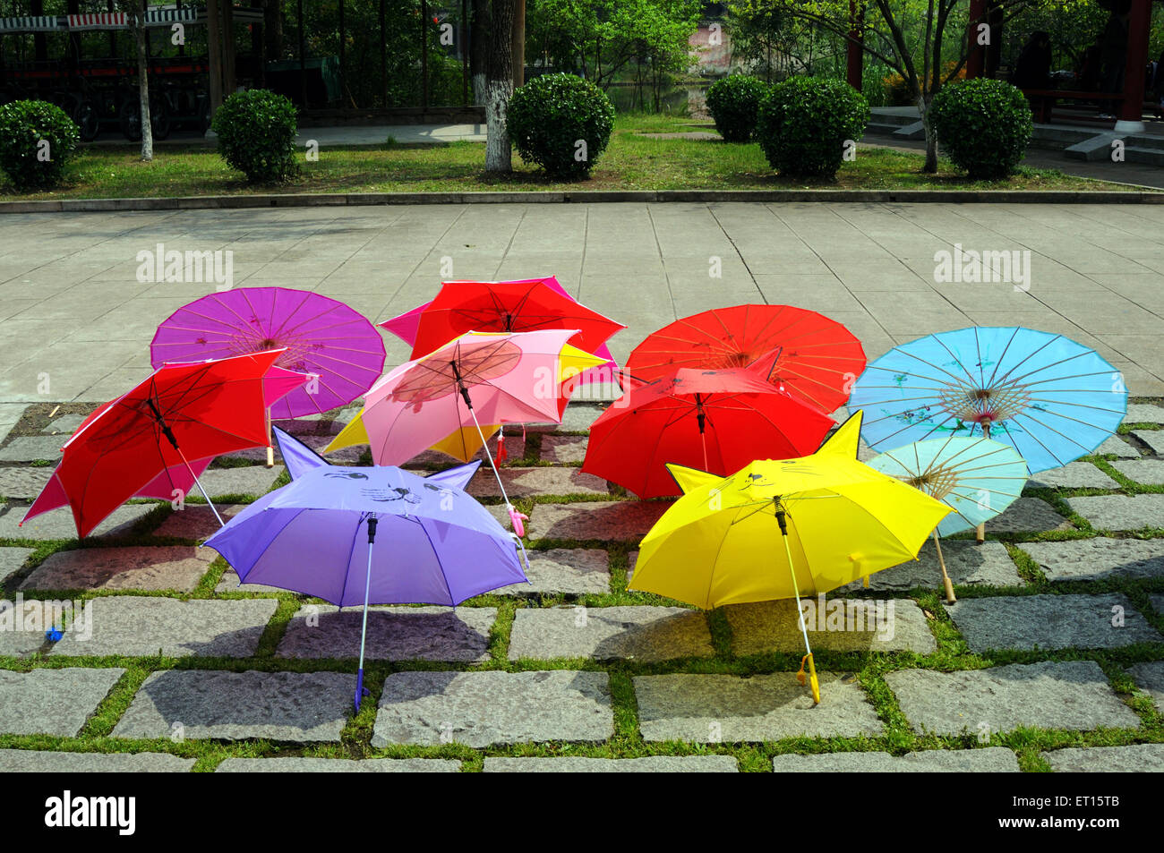 Colourful umbrellas displayed in chinese garden ; Beijing ; China - Stock Image