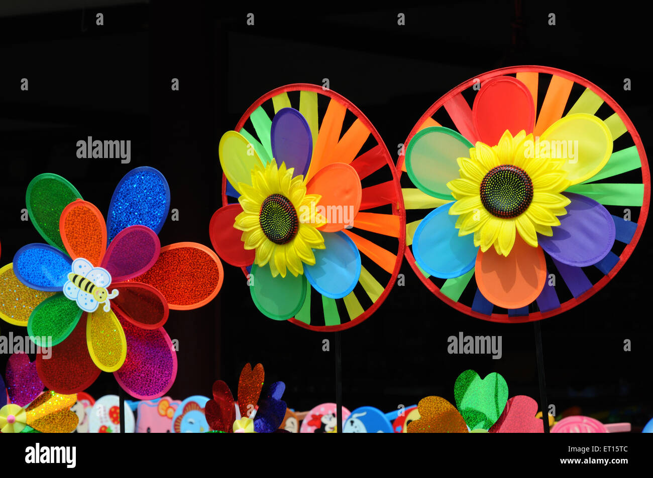 Colourful chinese paper wheels - Stock Image