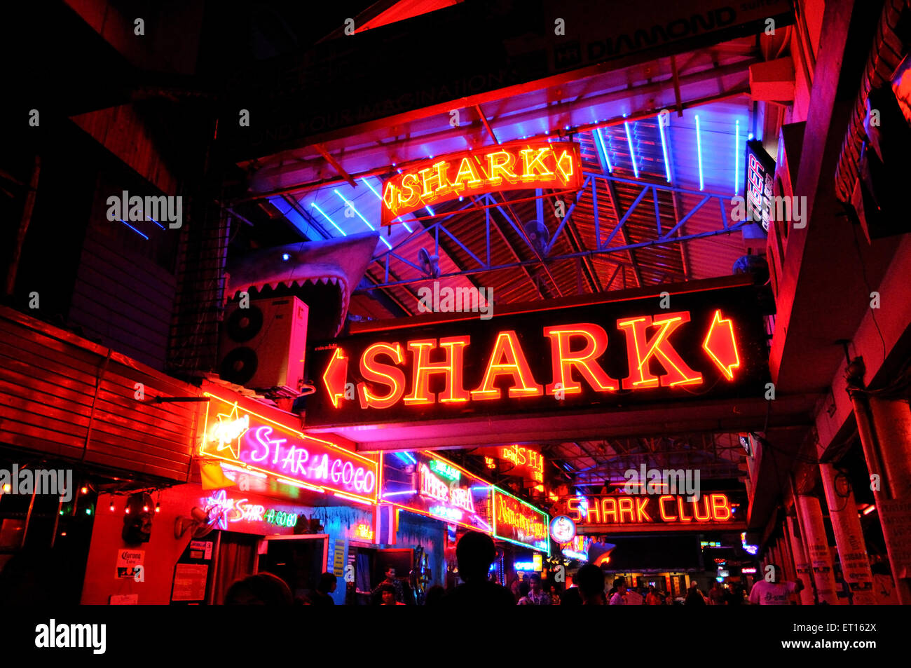 Night life and neon signs of nightclubs at Walking Street ; Pattaya Island ; Thailand - Stock Image