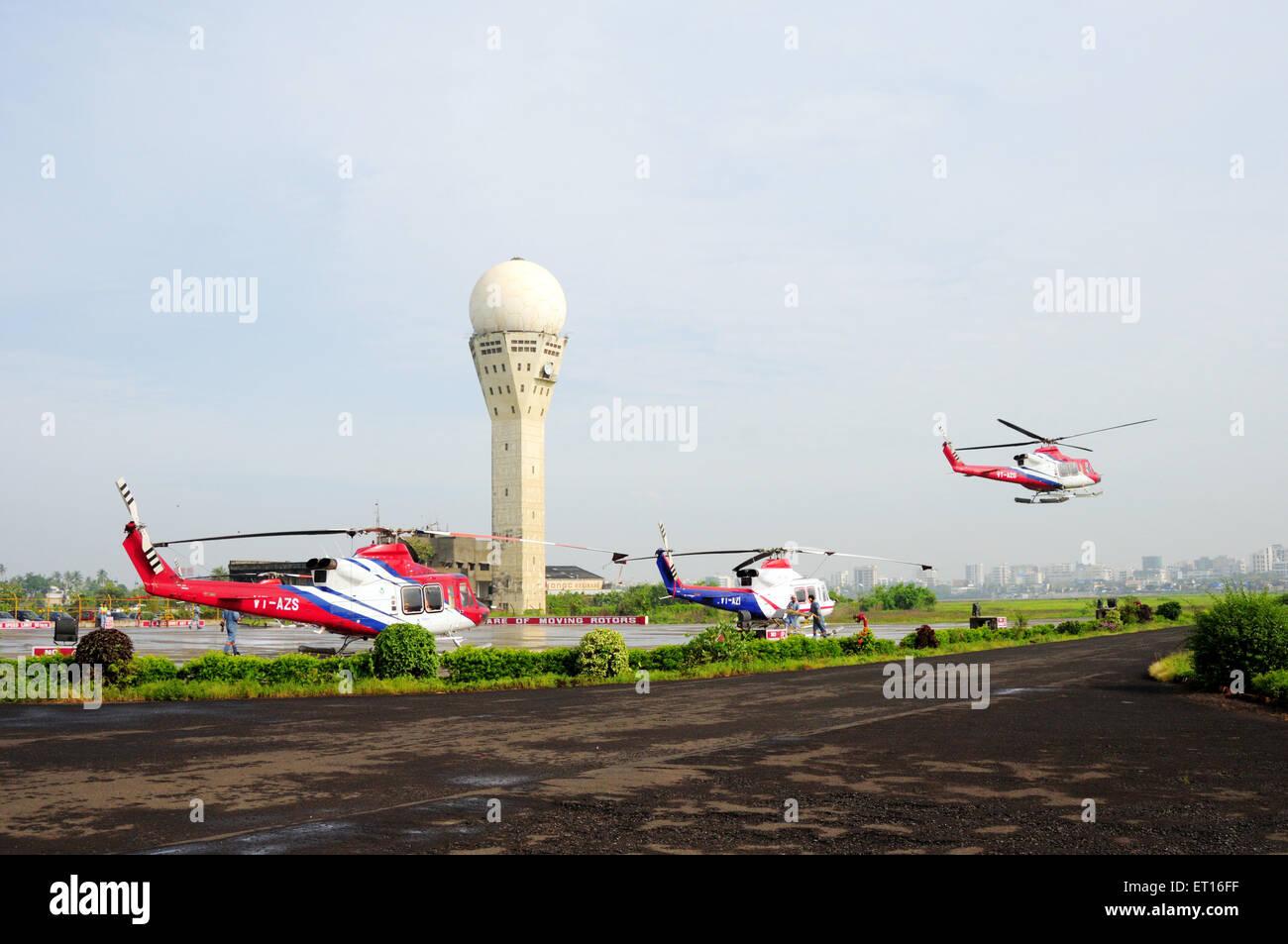 Helicopter taking off from Juhu airport ; Bombay Mumbai ; Maharashtra ; India - - Stock Image