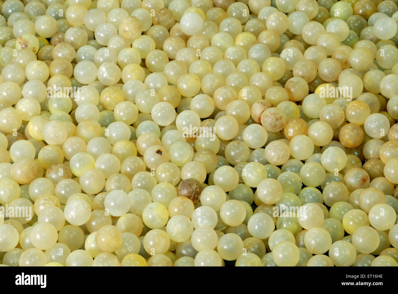 Ping pong balls used in industrial process ; India - Stock Image
