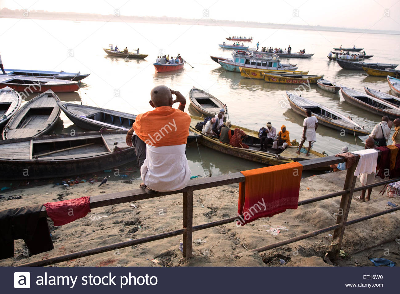 Pilgrim on banks of holy river ganga ganges in Varanasi ; Uttar Pradesh ; India - Stock Image