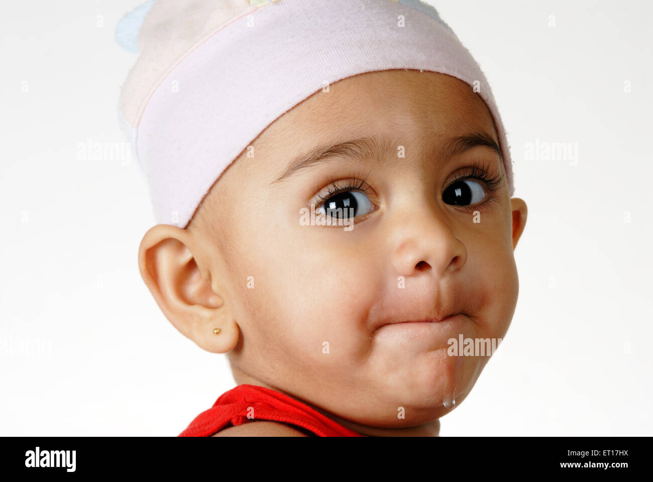 Indian baby boy lips pressed looking at camera India -  MR#512 - RMM 150201 - Stock Image
