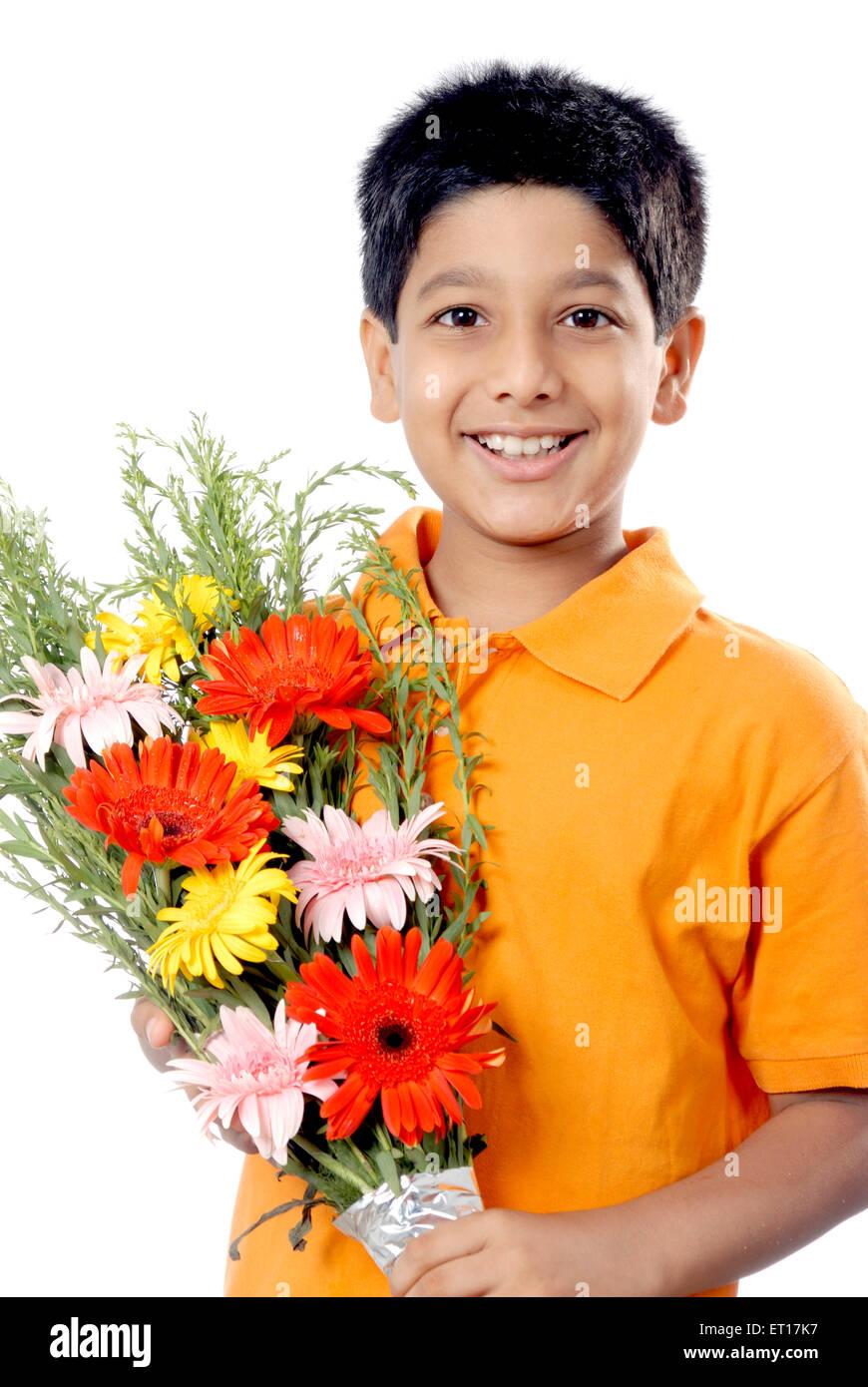 Boy holding flower bouquet MR#152 - Stock Image