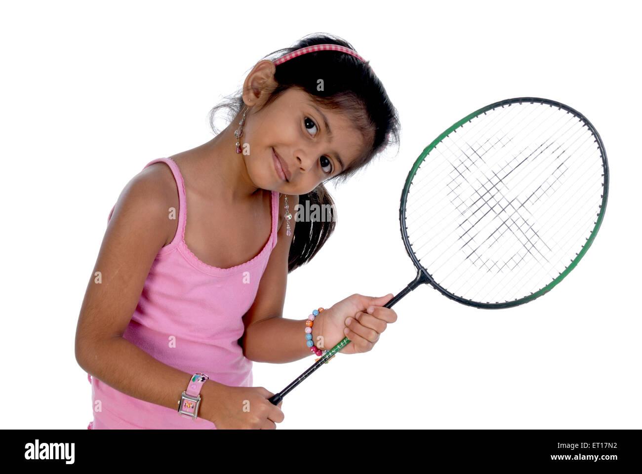 Girl holding a tennis racket ; Bombay now Mumbai ; Maharashtra ; India MR#736 M - Stock Image