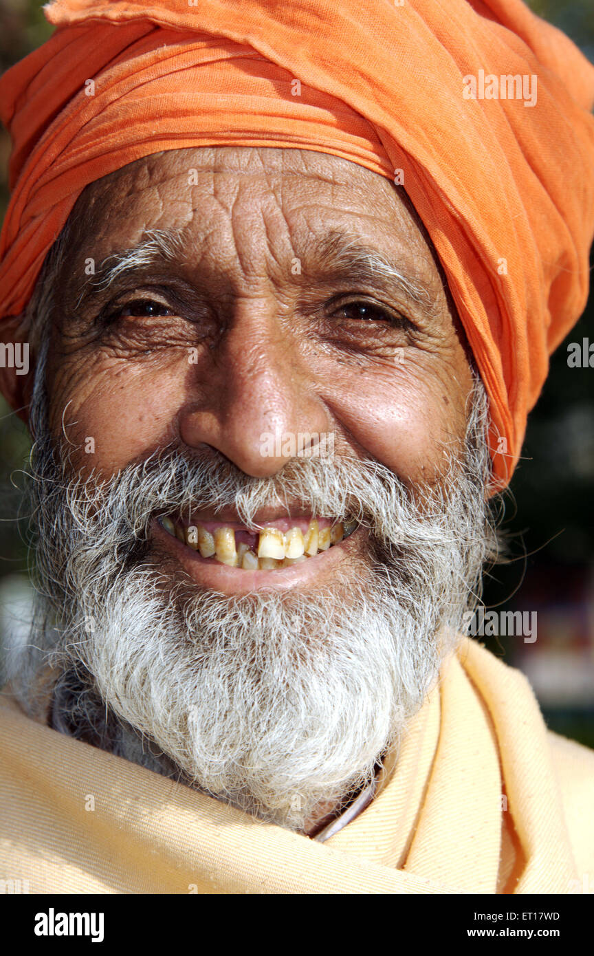 Priest laughing India Asia - Stock Image