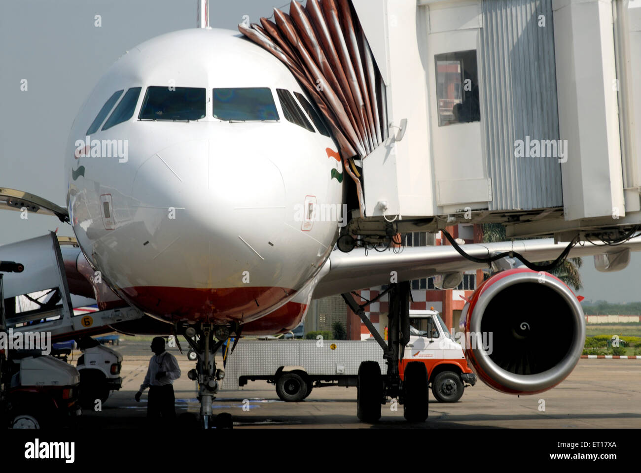 Aeroplane loading luggage at airport ; India No MR - Stock Image
