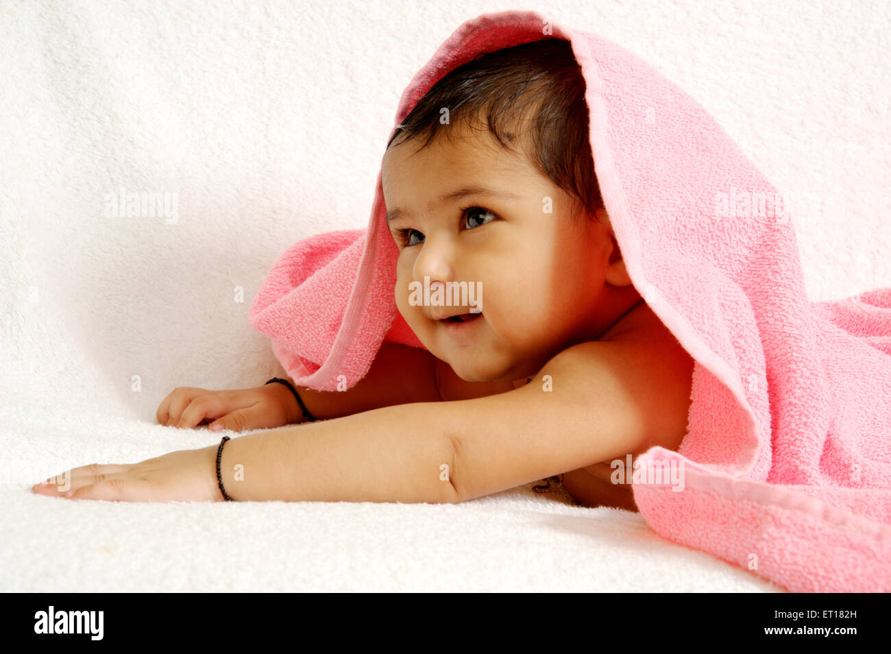 Three months Indian Baby boy Lying Towel MR#784F - Stock Image