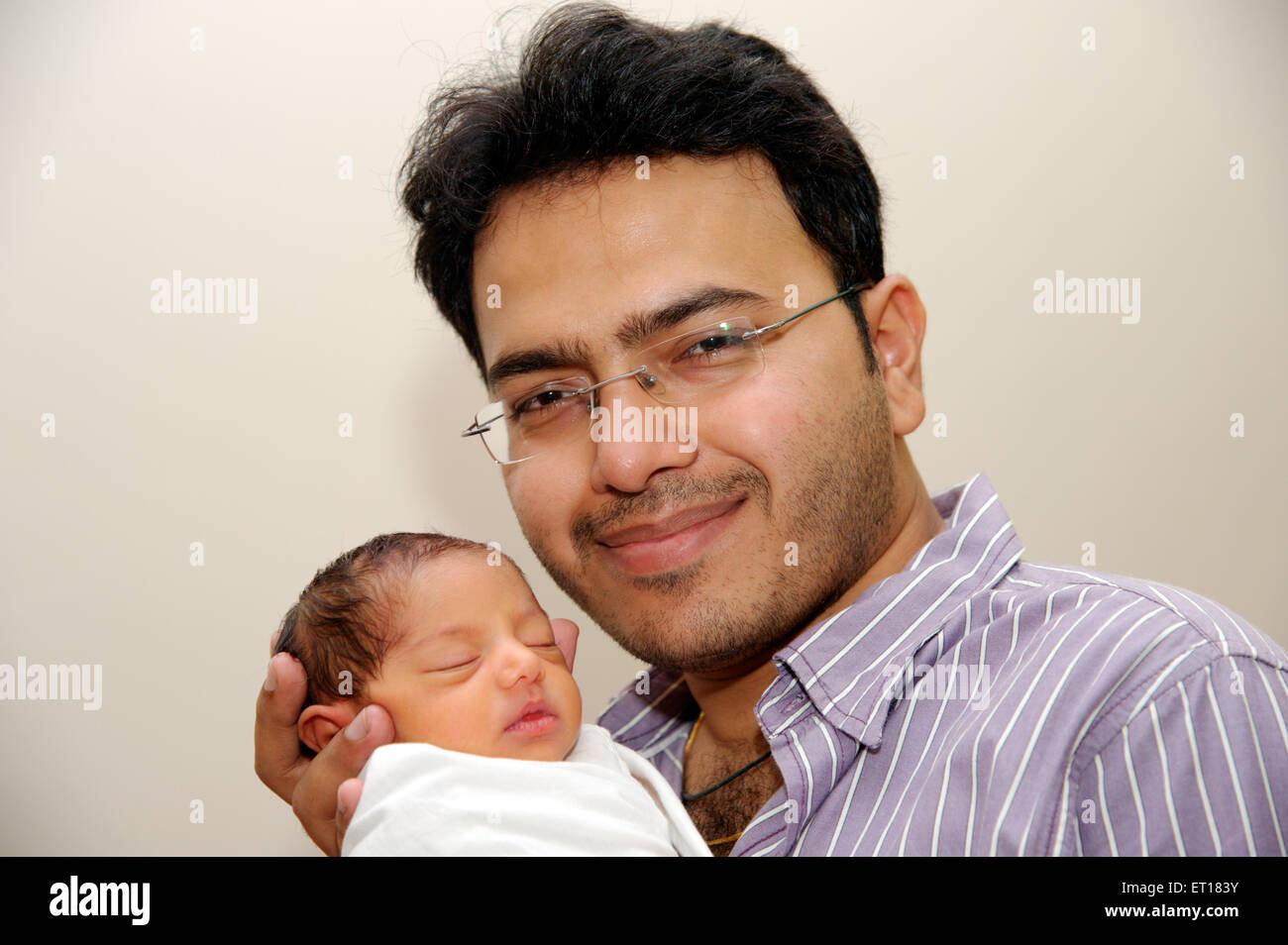 New born baby with uncle MR#736J MR#736LA - Stock Image