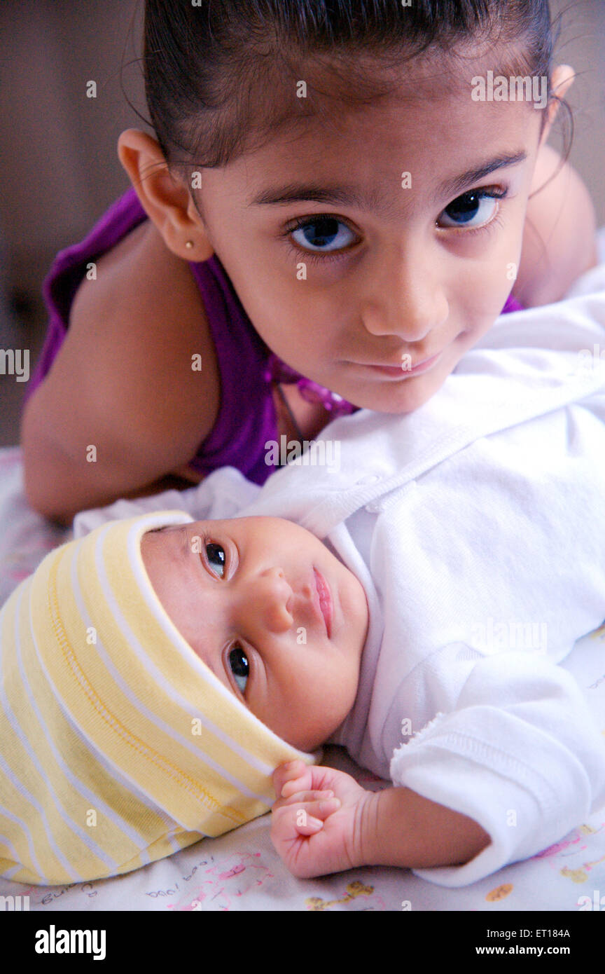 Indian baby with elder sister India MR#736L&LA Stock Photo