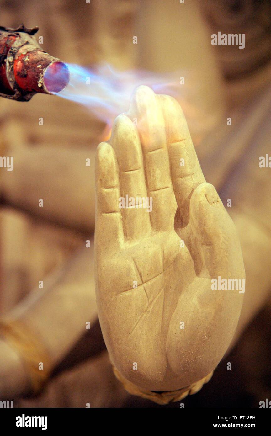 Hand of Lord Ganesh drying with help Stove Mumbai Maharashtra India Asia - Stock Image