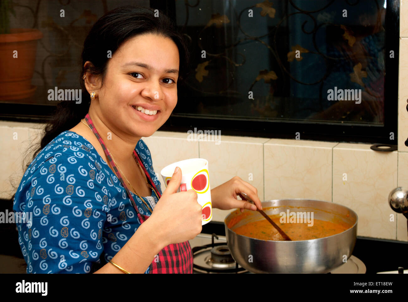 https://c8.alamy.com/comp/ET18EW/indian-young-woman-cooking-in-the-kitchen-mr364-ET18EW.jpg Indian Woman Cooking