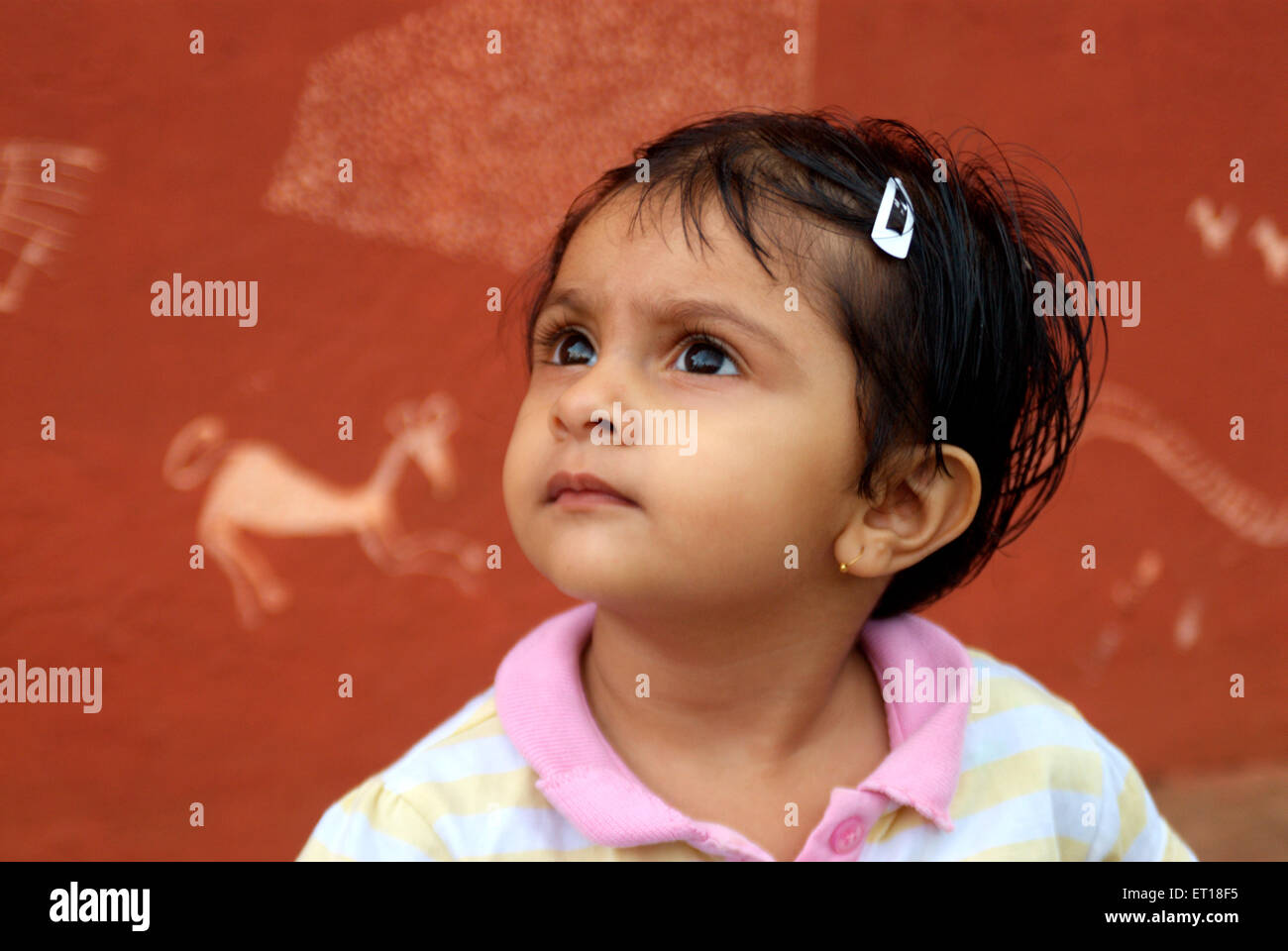 Baby looking up hair tied with clip MR#364 - Stock Image