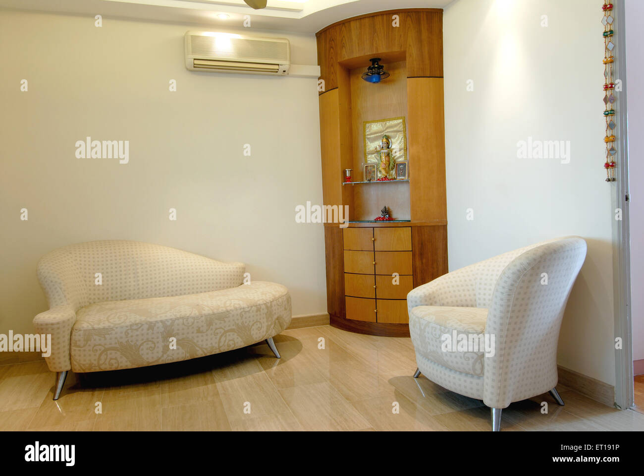 Interior of drawing room with sofa air conditioner - Stock Image