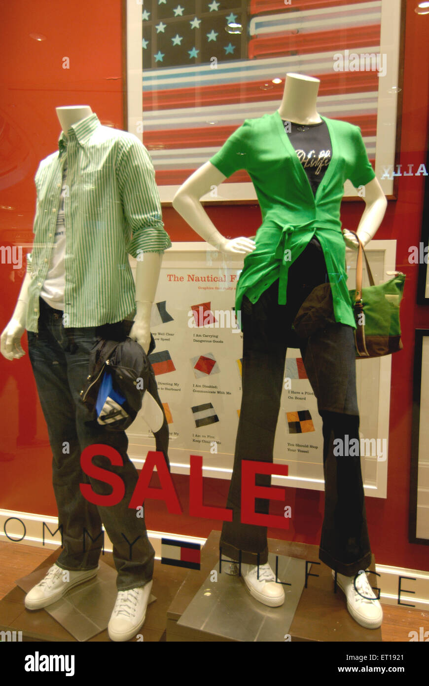 Mannequins in colourful dress in showcase ; Singapore - Stock Image
