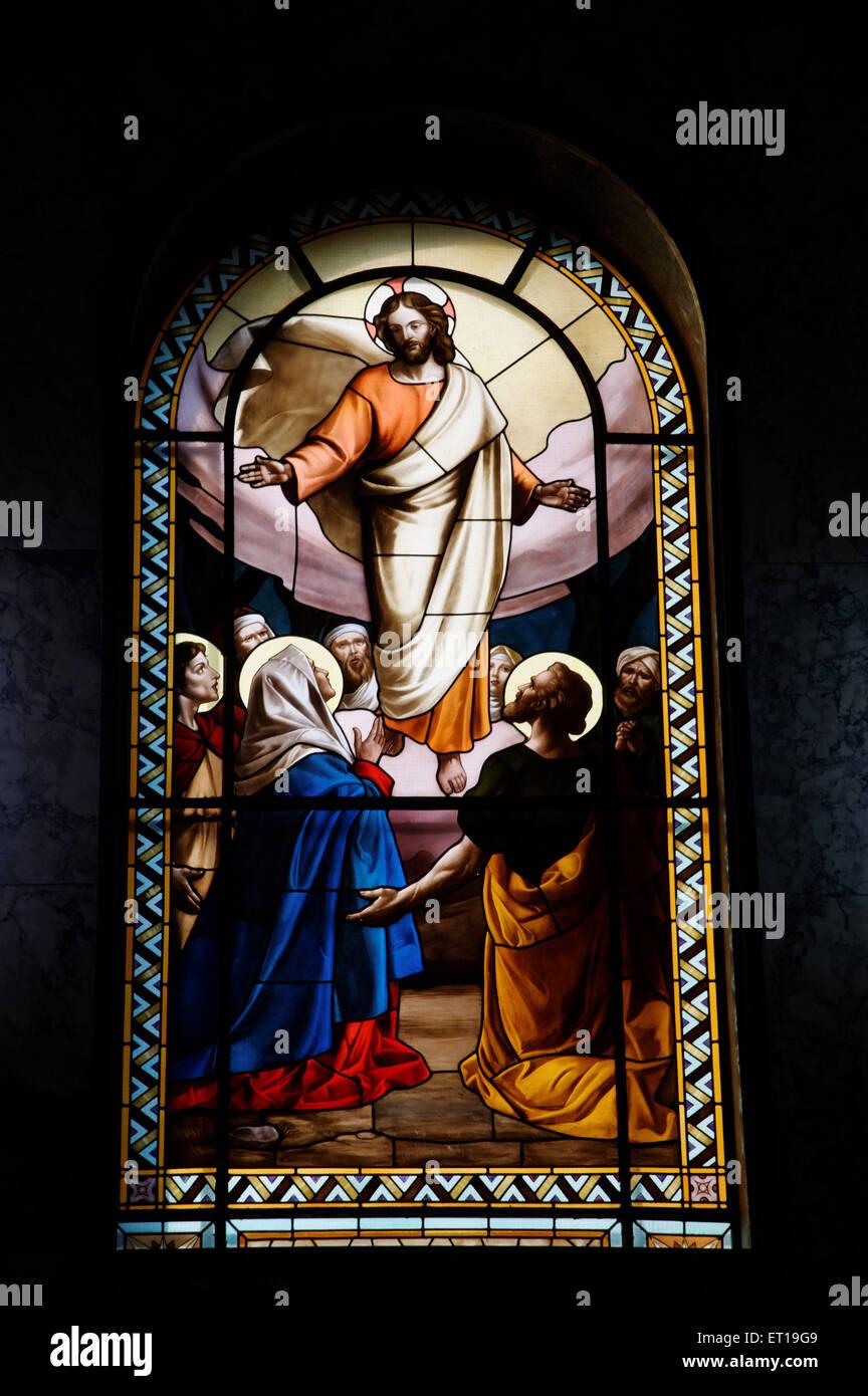 jesus christ depicted on stained glass don bosco church mumbai Maharashtra India Asia - Stock Image