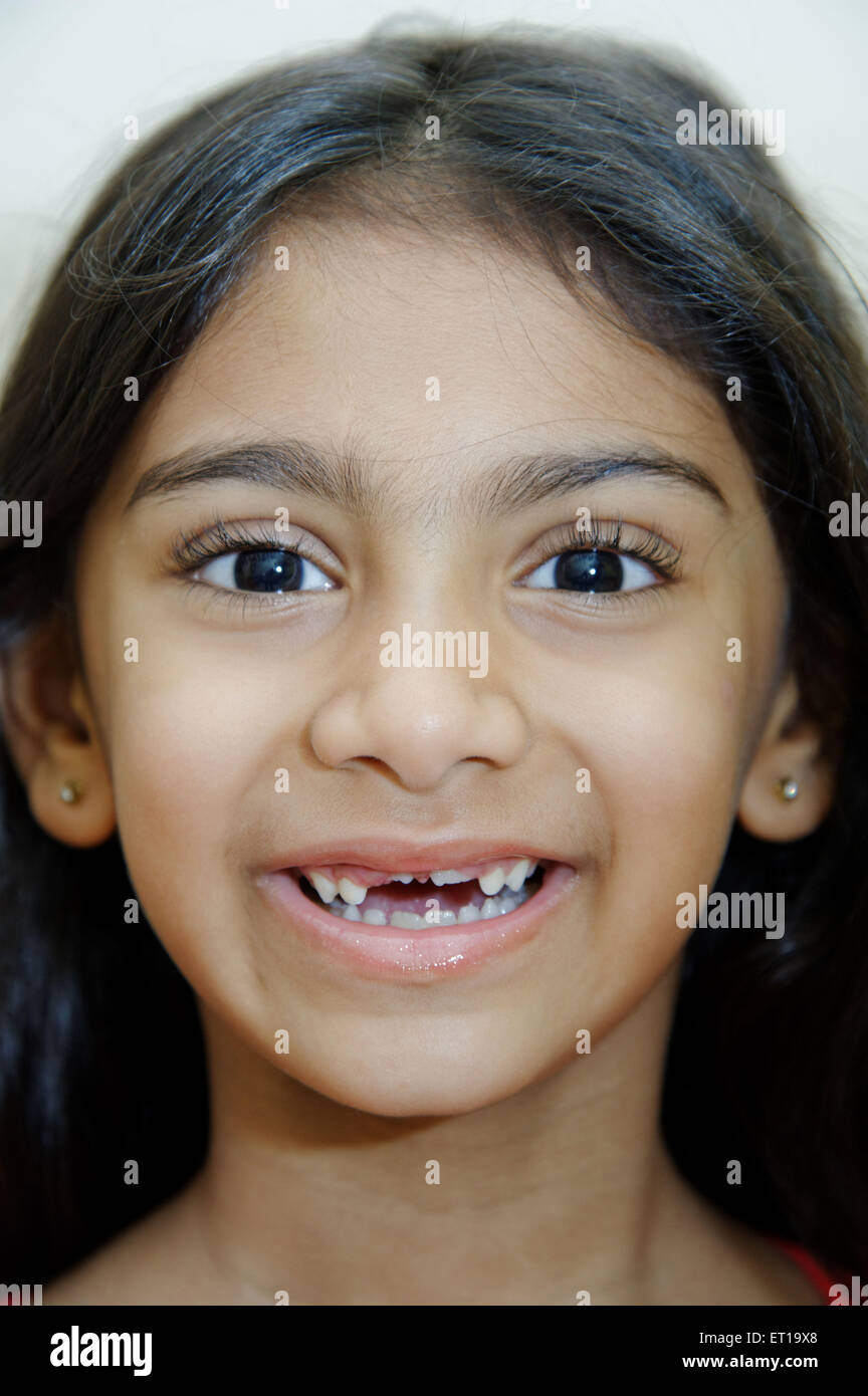 Six Years Old Indian Girl laughing MR#736L Stock Photo