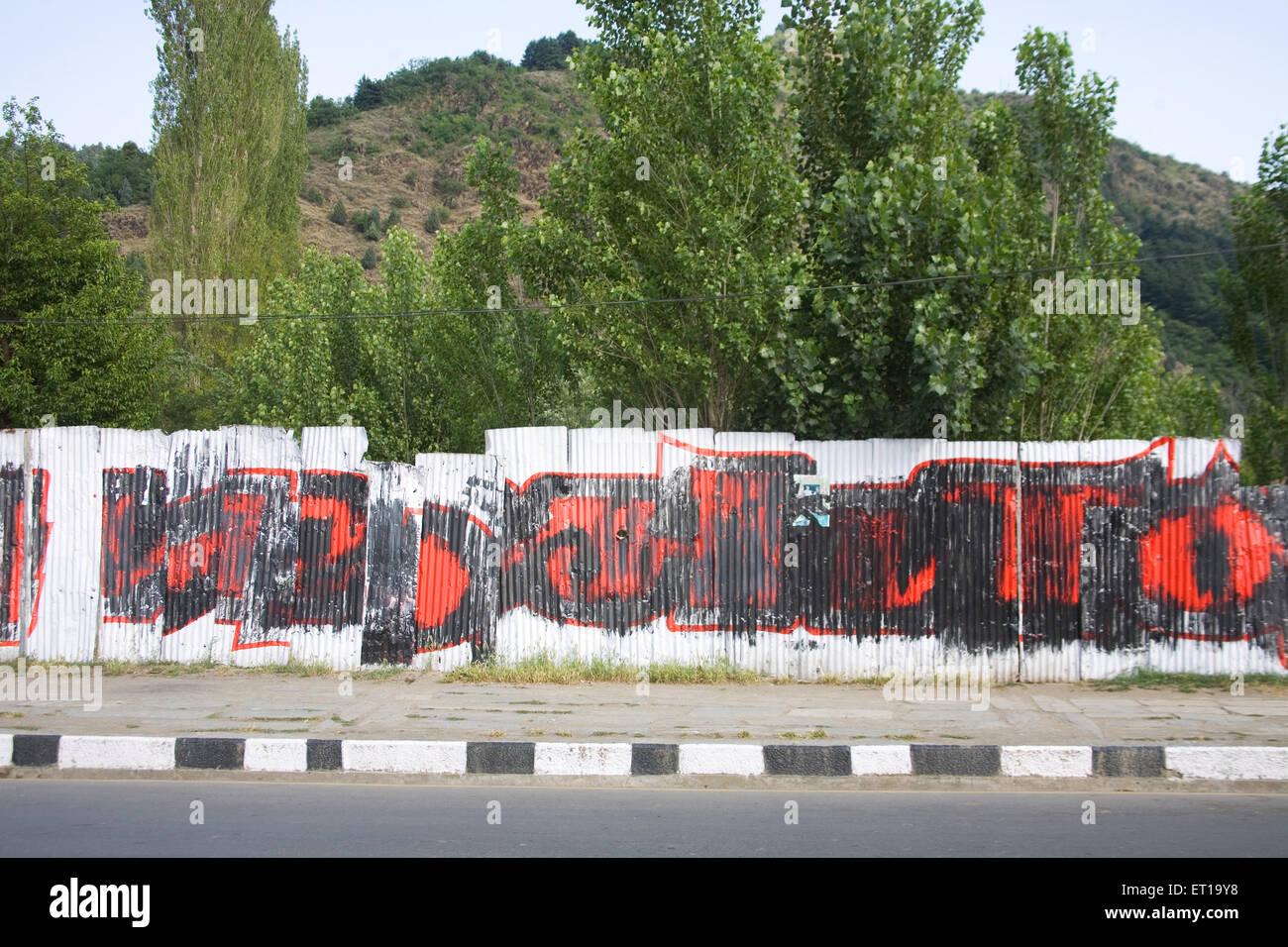 Slogan written on tin ; Srinagar ; Jammu and Kashmir ; India - Stock Image