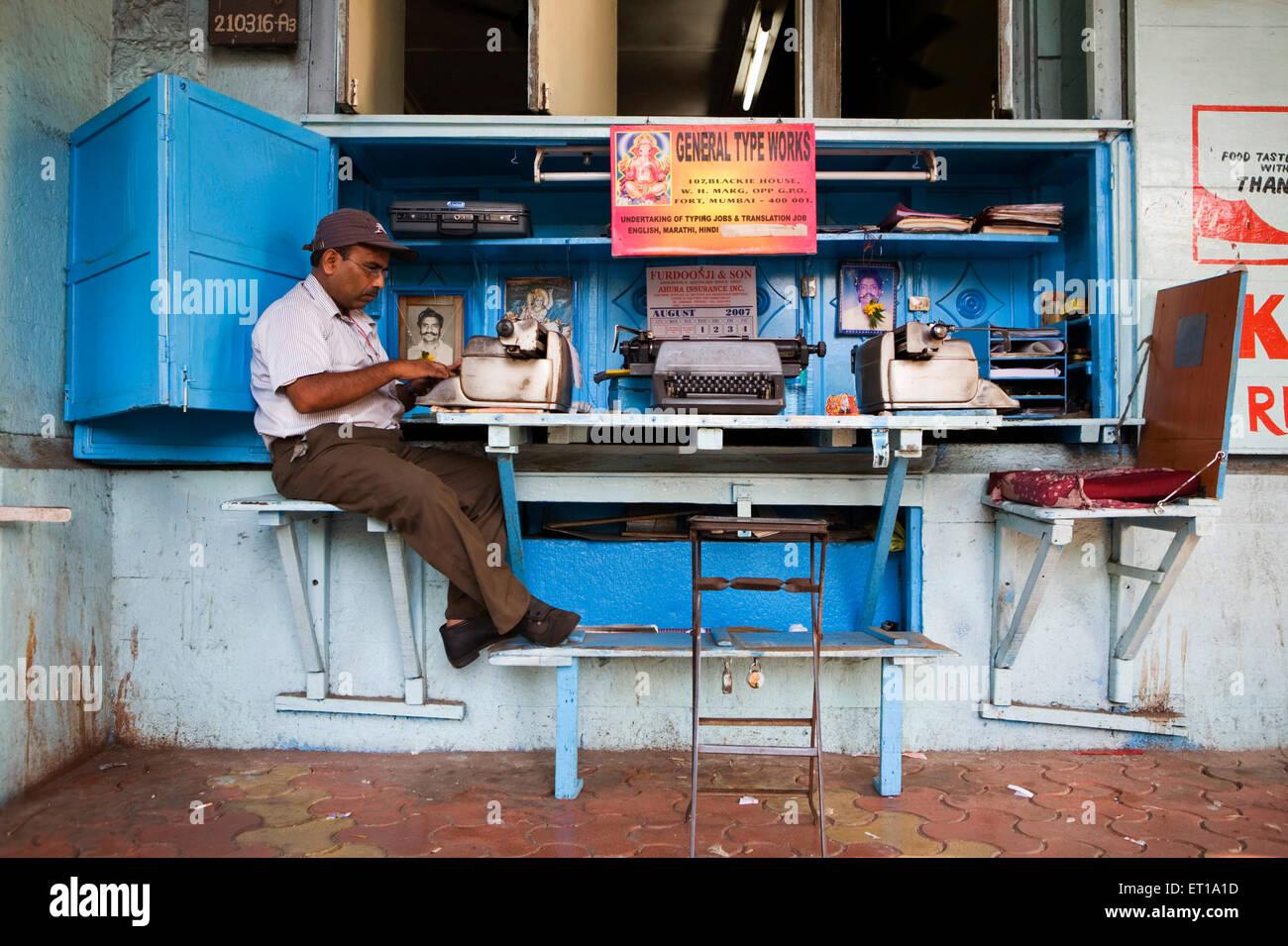 Typist typing document ; Bombay Mumbai  ; Maharashtra ; India - Stock Image