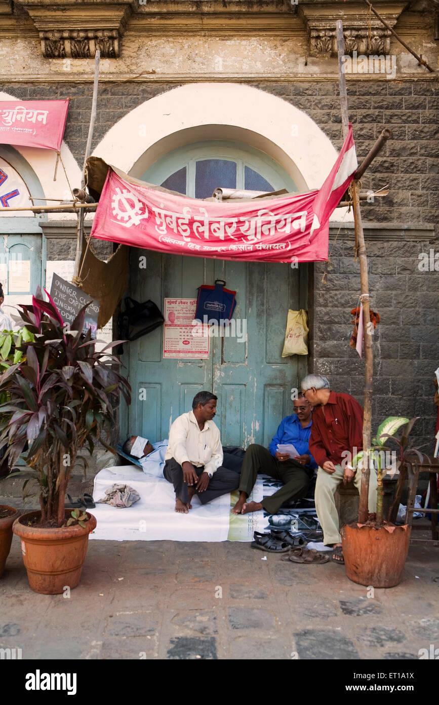 Striking workers belonging to Mumbai Labour Union protesting with banner ; Bombay Mumbai  ; Maharashtra ; India - Stock Image