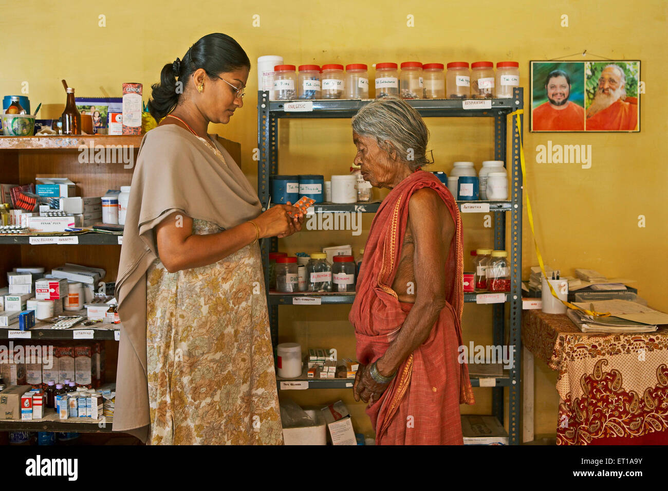 Health workers of NGO Chinmaya Organization of Rural Development CORD giving medicines - Stock Image