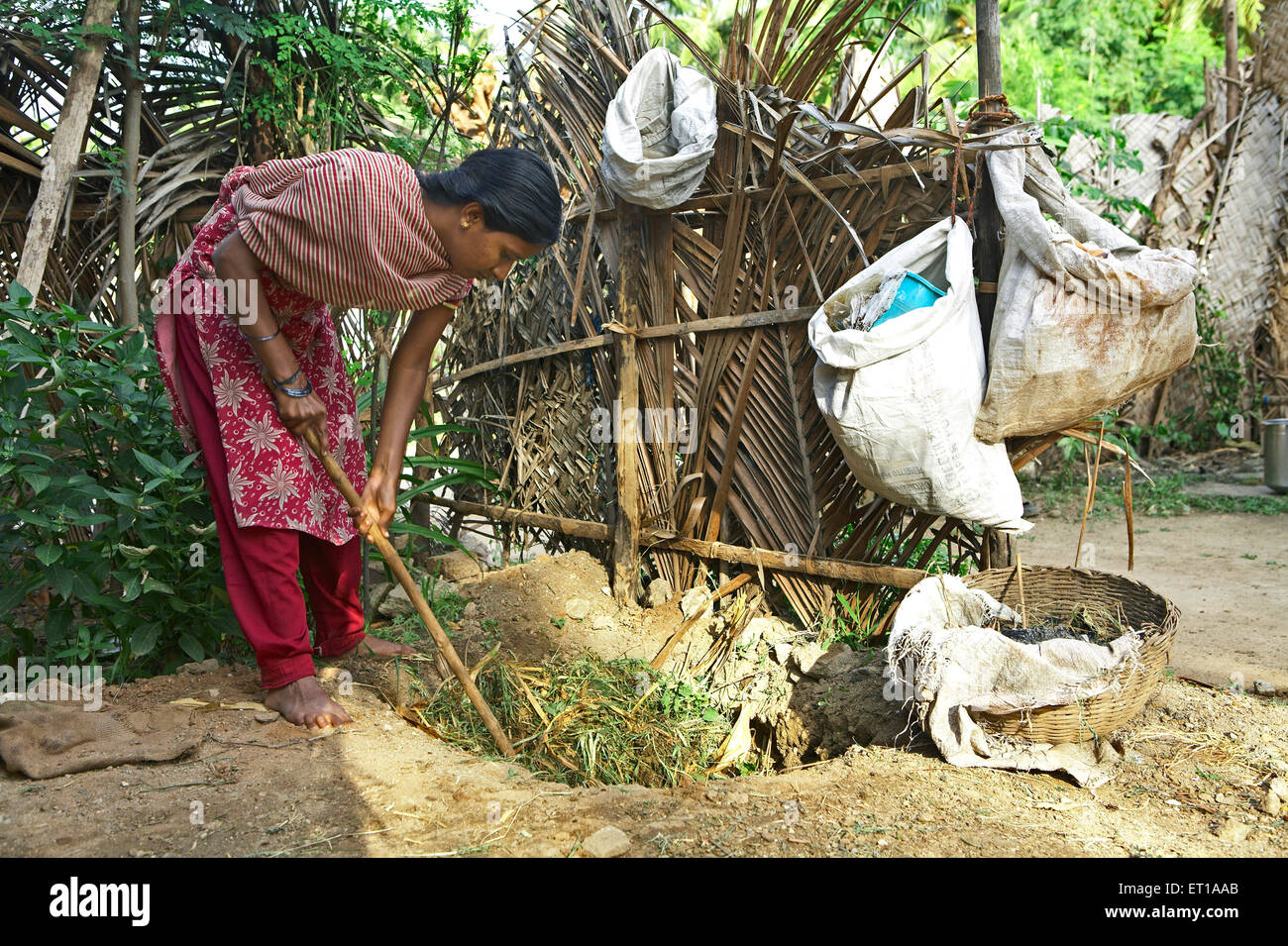 Volunteer of NGO Chinmaya Organization of Rural Development  CORD making compost manure from organic waste Stock Photo