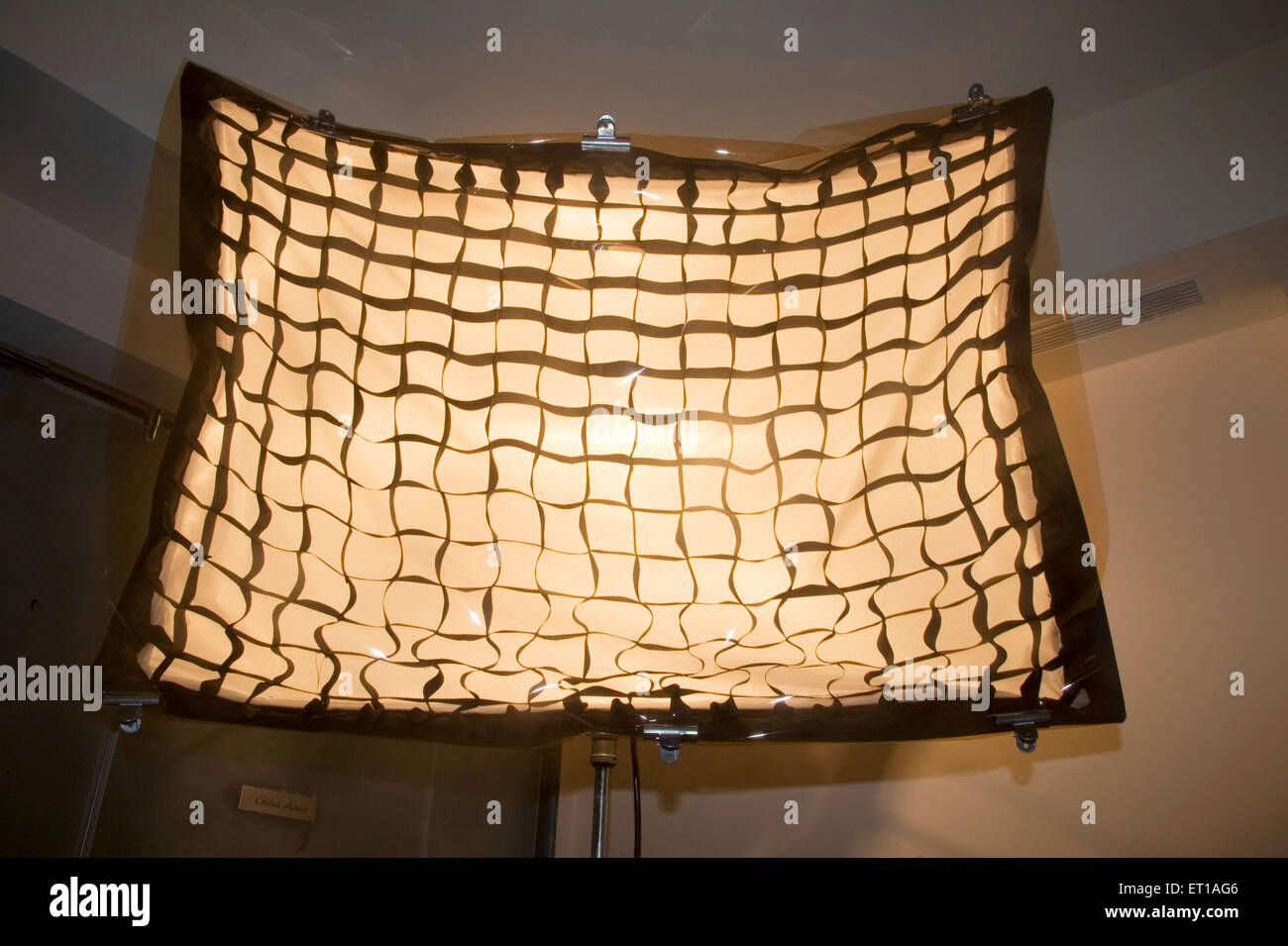 Artificial professional cine soft box light covered black squares effect Photography ; Palolem beach ; Goa ; India - Stock Image