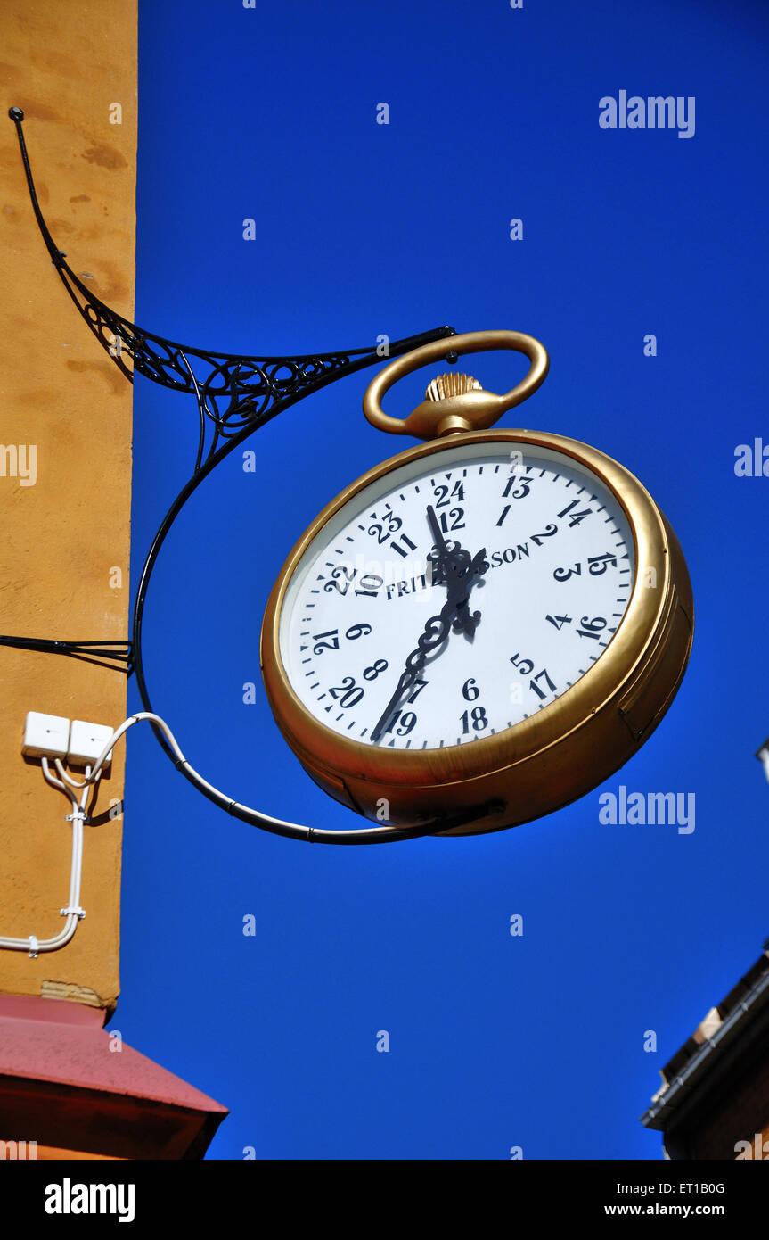 mounted street clock lulea Sweden - Stock Image