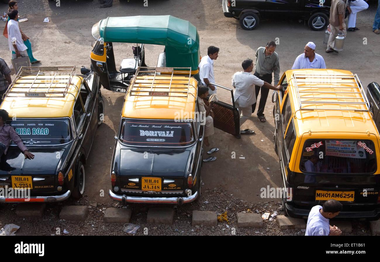 Vehicles parked outside at Borivali ; Bombay Mumbai ; Maharashtra ; India - Stock Image