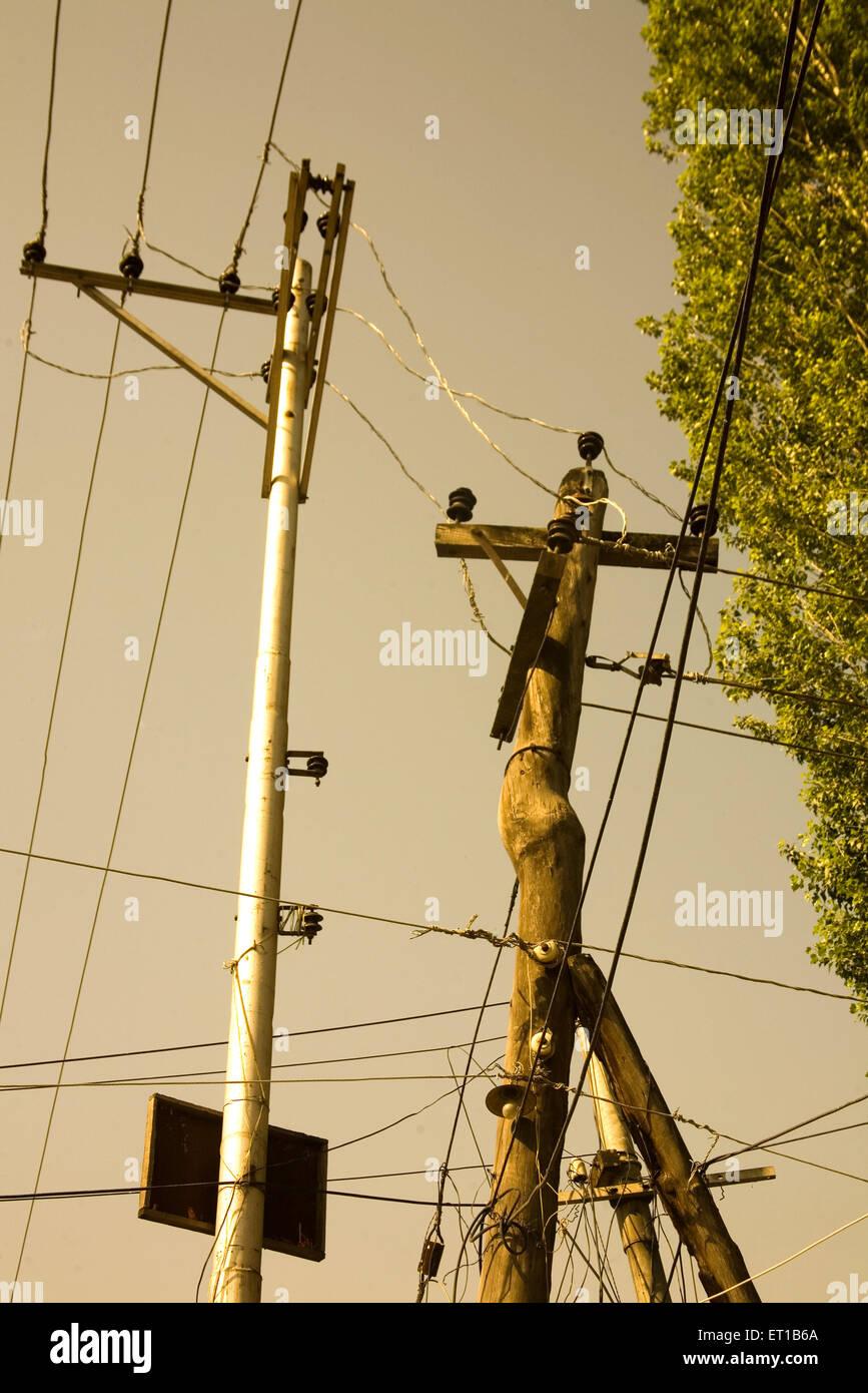 Power supply electrical pole of aluminum and wood  at Srinagar ; Jammu and Kashmir ; India - Stock Image