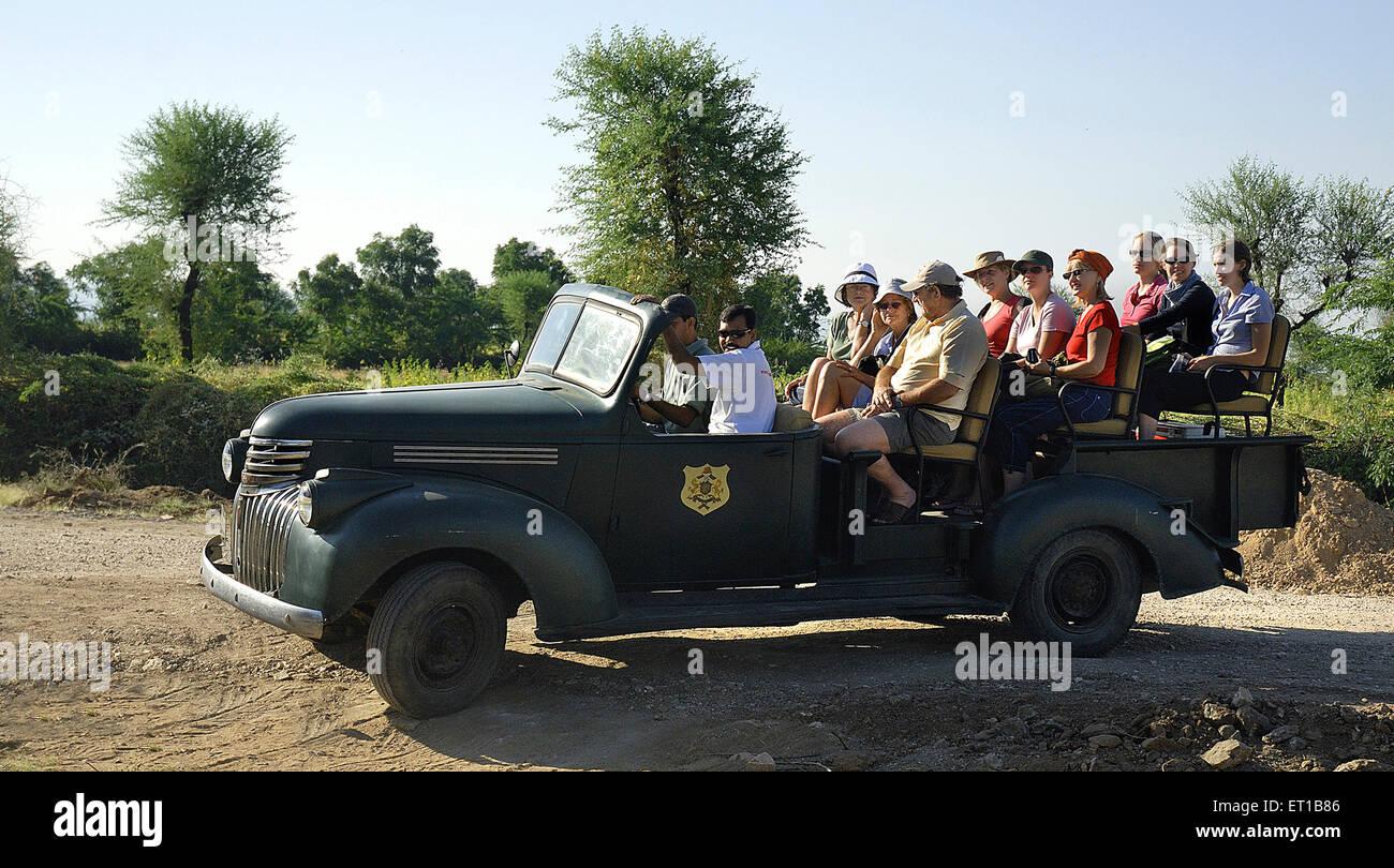 Tourists in vintage car at Rawla Jojwar heritage hotel ; Marwar ; Rajasthan ; India PR#746B - Stock Image