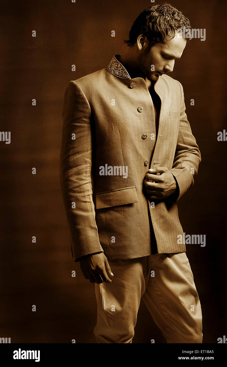 Man standing in traditional dress ; Jodhpur ; Rajasthan ; India MR#746A - Stock Image