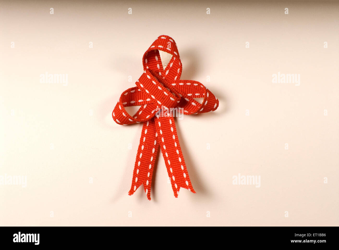 Ribbon knot on white background - Stock Image