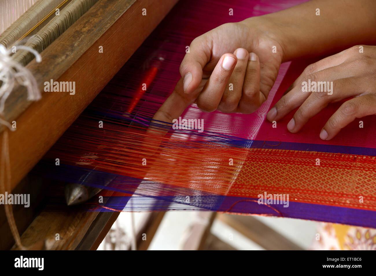 Woman weaving saree on handloom Maharashtra India Asia Stock Photo