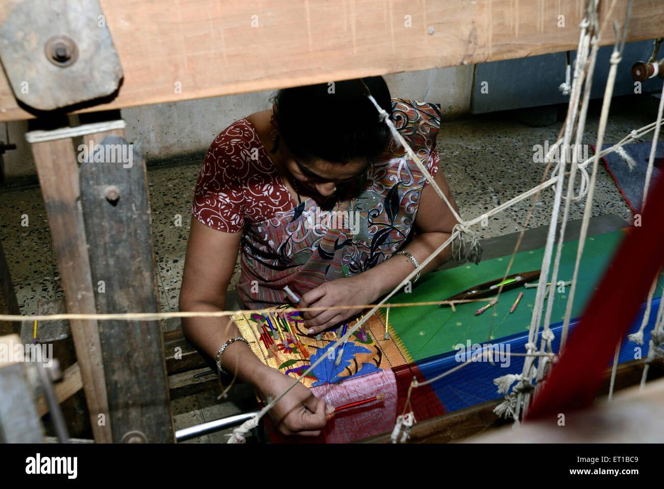 Woman Weaving Saree on Handloom at Maharashtra India Asia - Stock Image