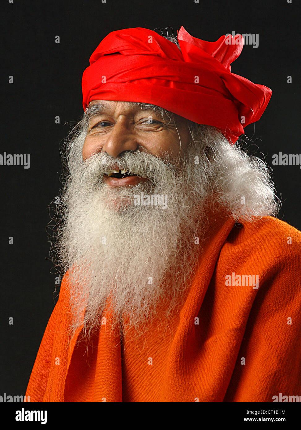 Old sadhu laughing in red turban ; Jodhpur ; Rajasthan ; India MR#746B - Stock Image