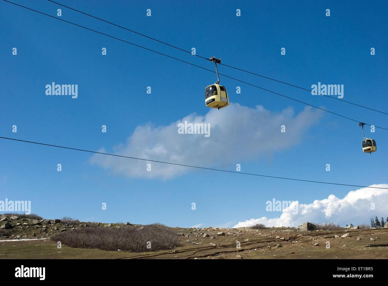 Trolleys rope way against blue sky Gulmarg Jammu and Kashmir India Asia - Stock Image