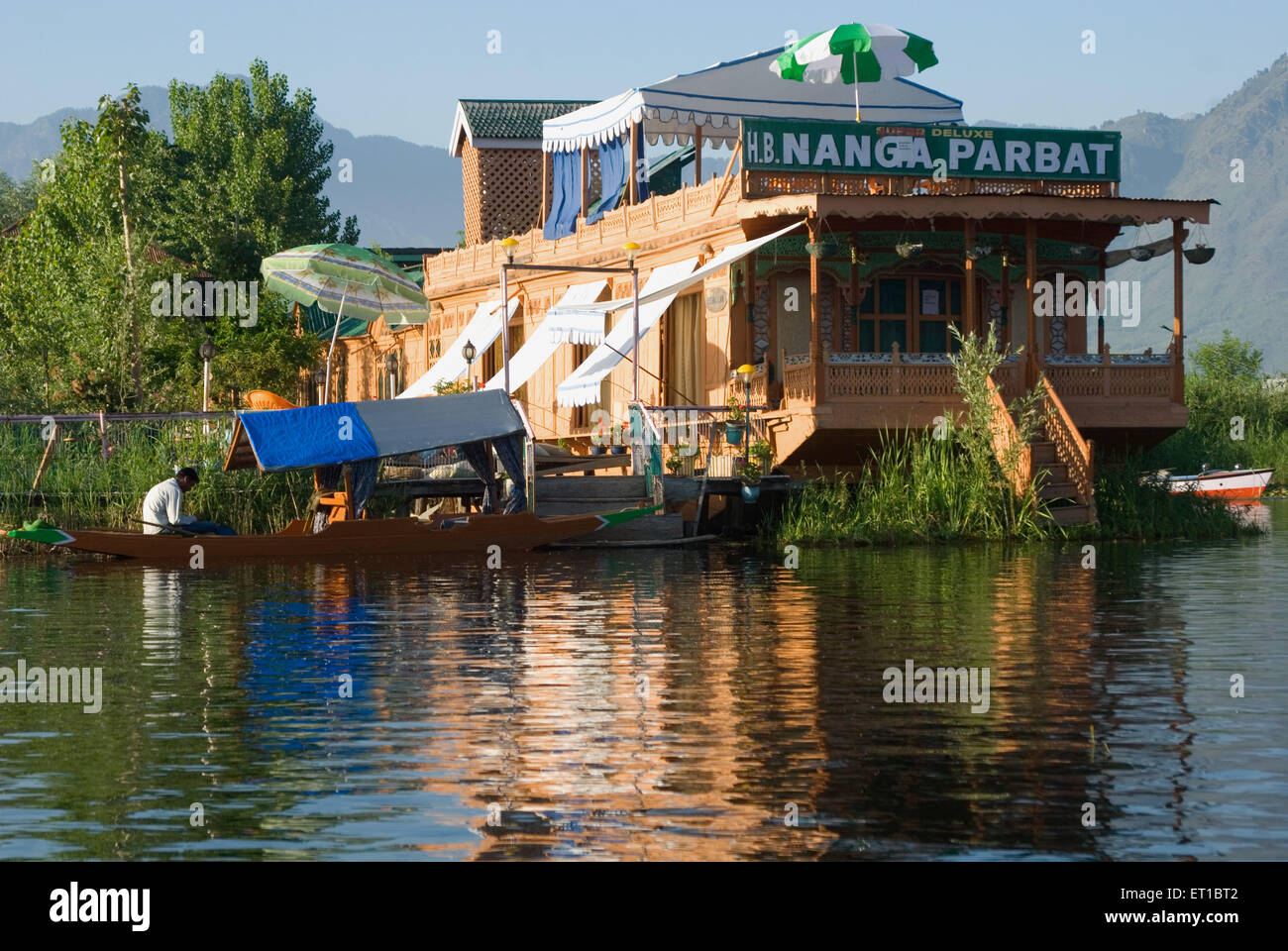 A house boat in dal lake Srinagar Jammu and Kashmir India Asia - Stock Image