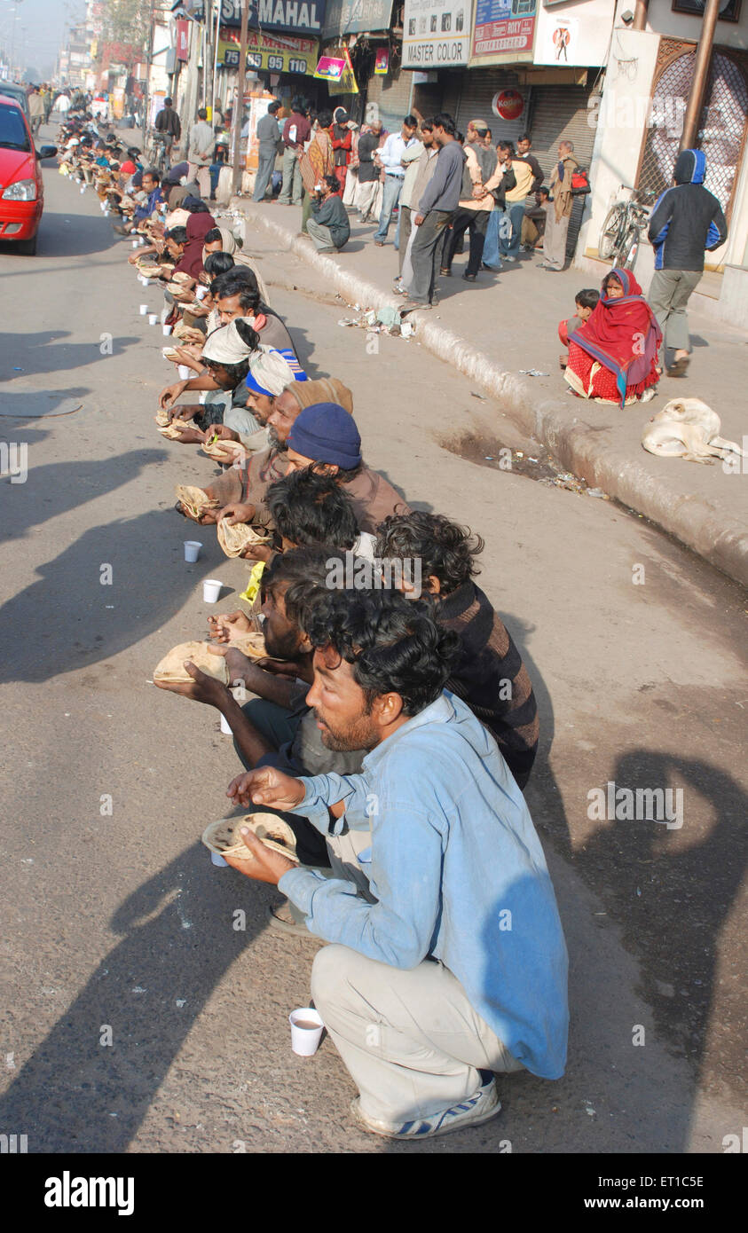 Meals in group for poor langar in Chandni Chowk area every morning ; Delhi ; India - Stock Image