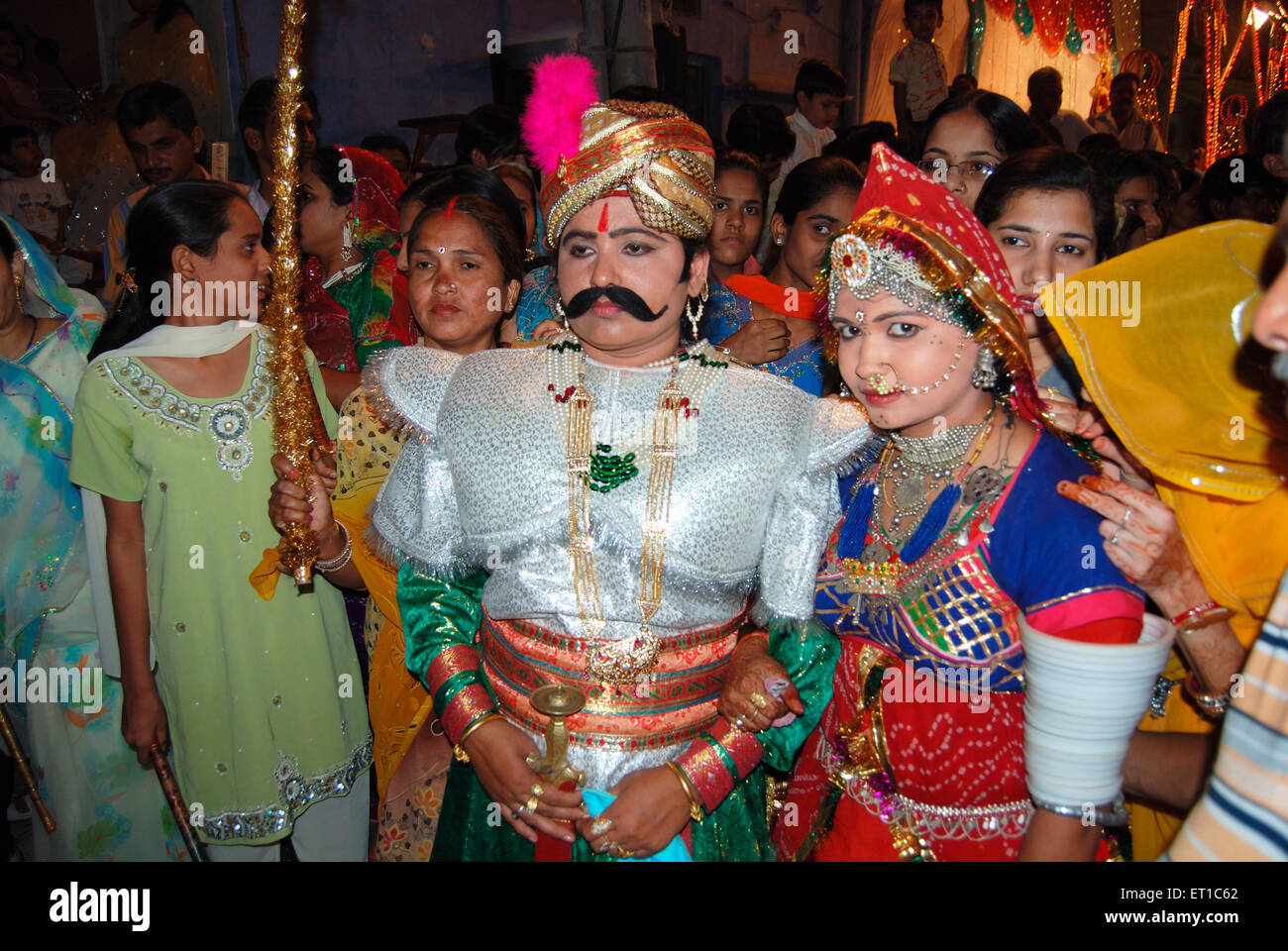 Two women in disguise of bridegroom and bride on Dheenga Gavar festival ; Jodhpur ; Rajasthan ; India NO MR - Stock Image