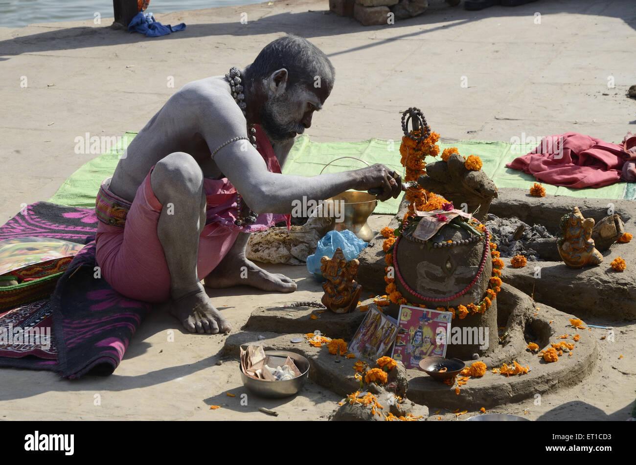 sadhu performing Shiva Linga Puja in Varanasi Ghat at Uttar Pradesh India Stock Photo