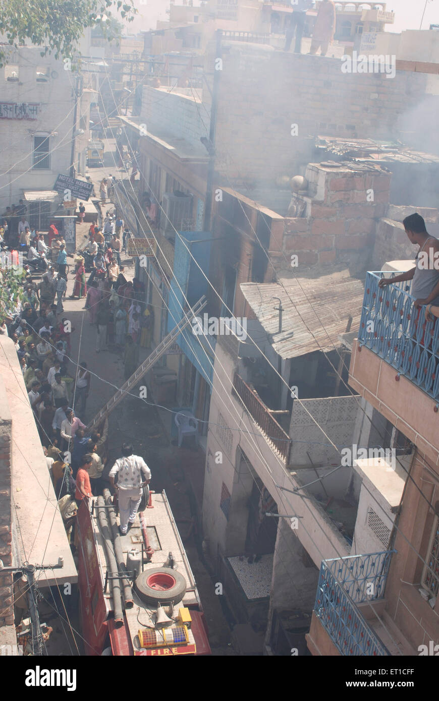 Rescue work in fire victim house in lane ; Jodhpur ; Rajasthan ; India - Stock Image
