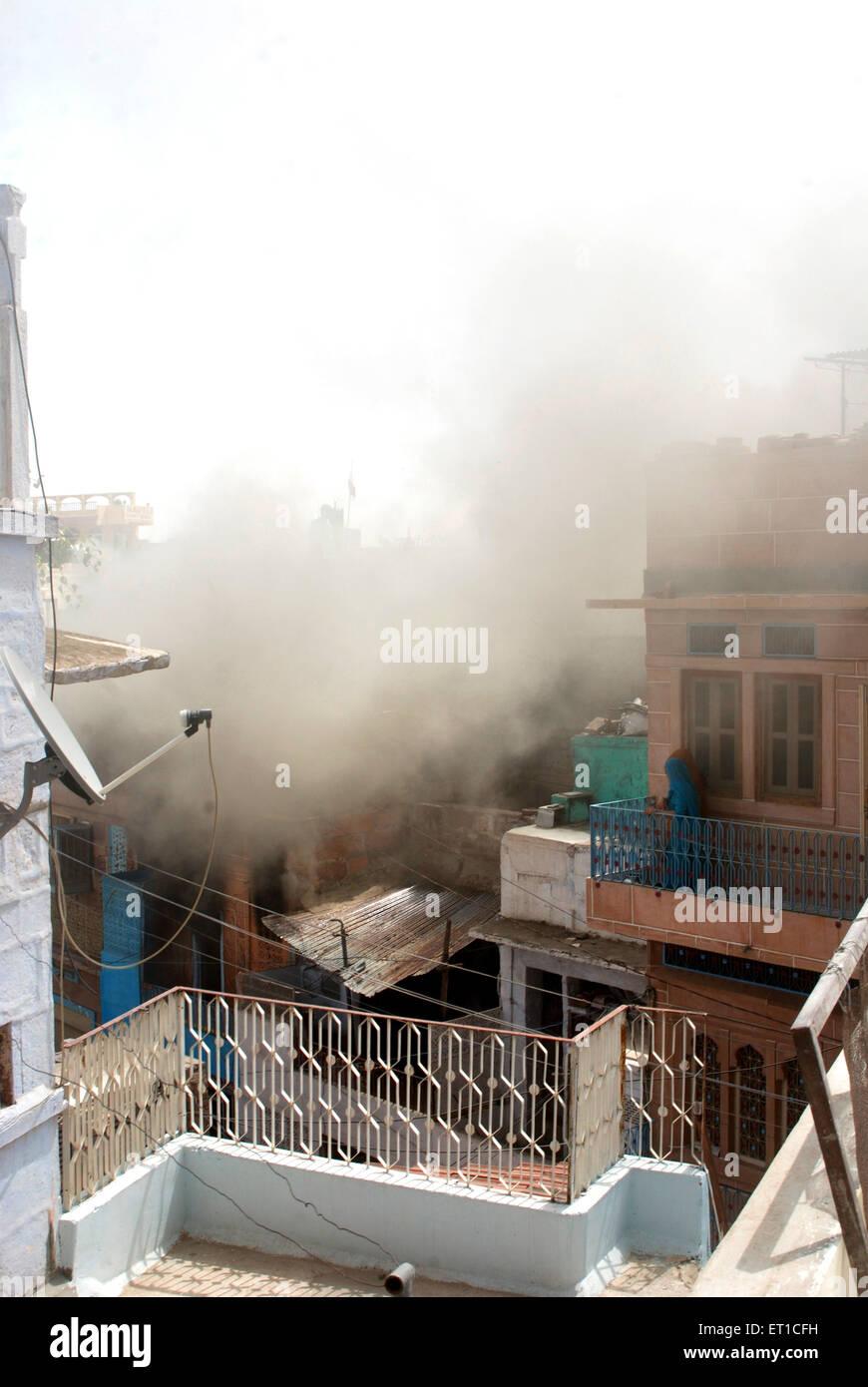 Smoke from fire victim house in lane ; Jodhpur ; Rajasthan ; India - Stock Image