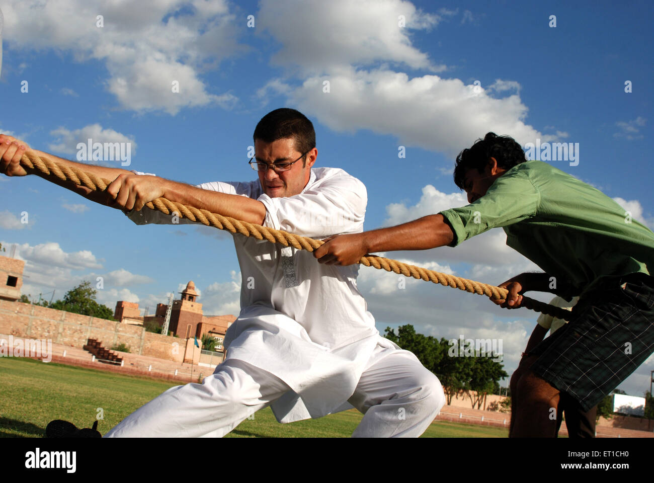 Foreign tourists playing tug of war in marwar festival ; Jodhpur ; Rajasthan ; India NO MR - Stock Image
