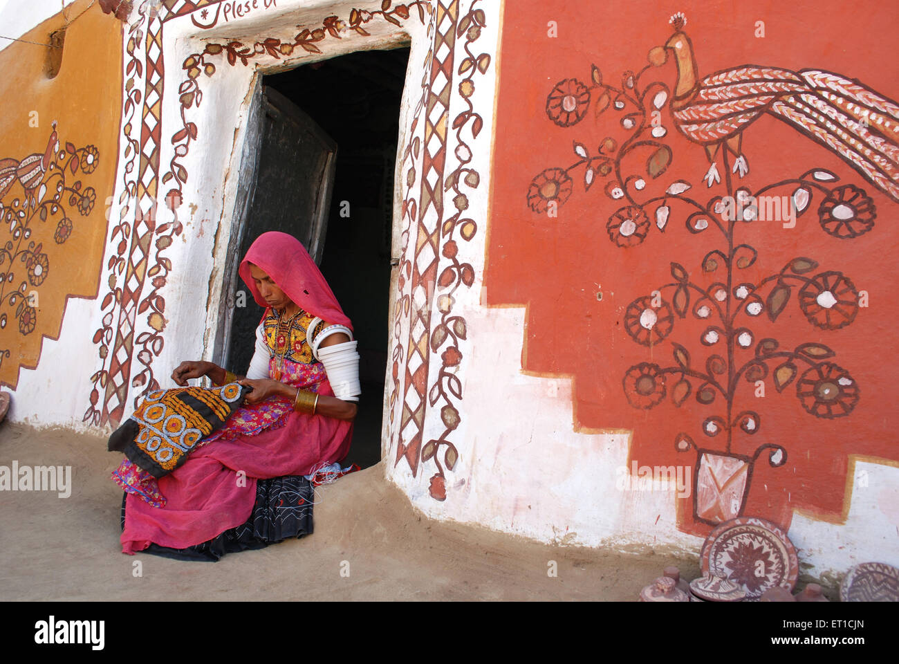 Indian woman doing embroidery work Khuri Jaisalmer Rajasthan India Stock Photo