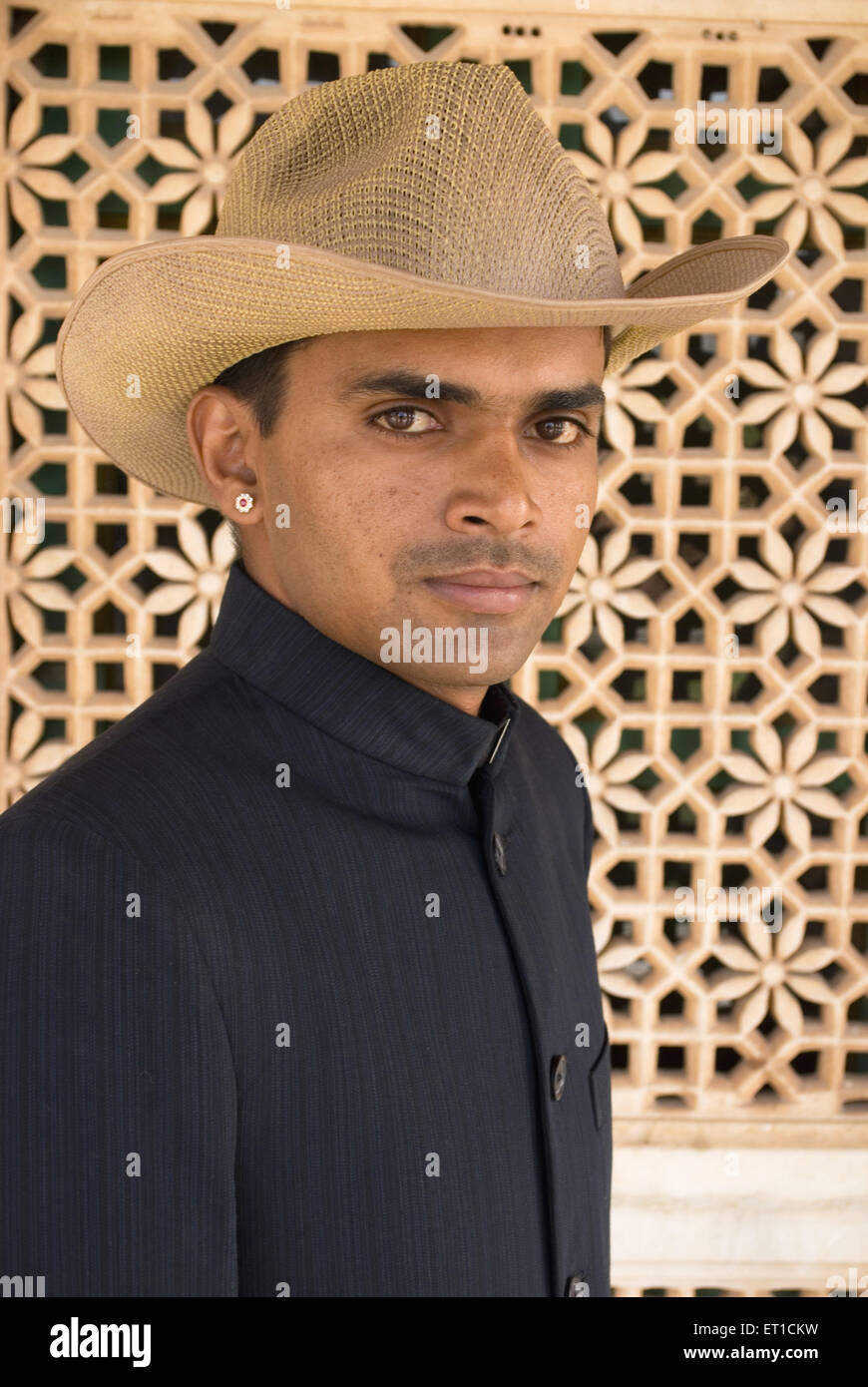 Tourist guide in coat and hat ; Rajasthan ; India MR#704F - Stock Image