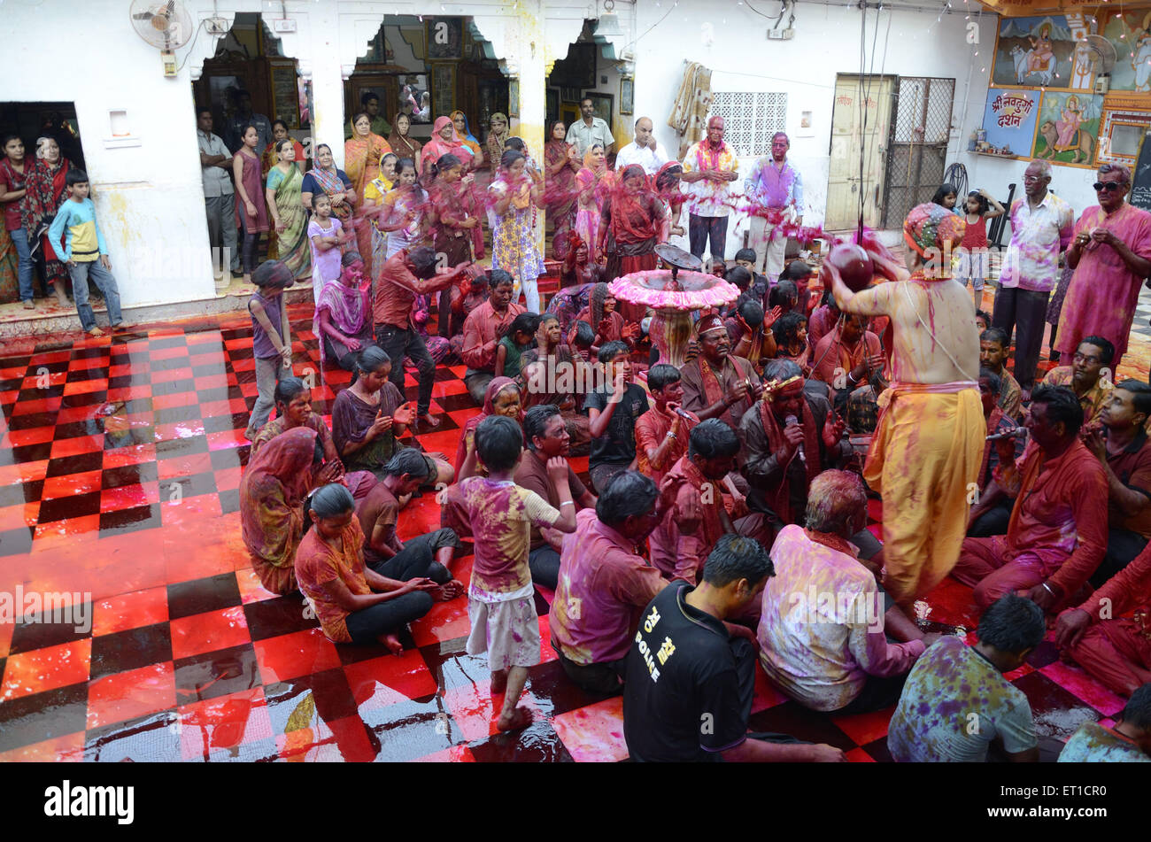 Men and women singing devotional songs in Gang shyamji temple at Jodhpur India - Stock Image