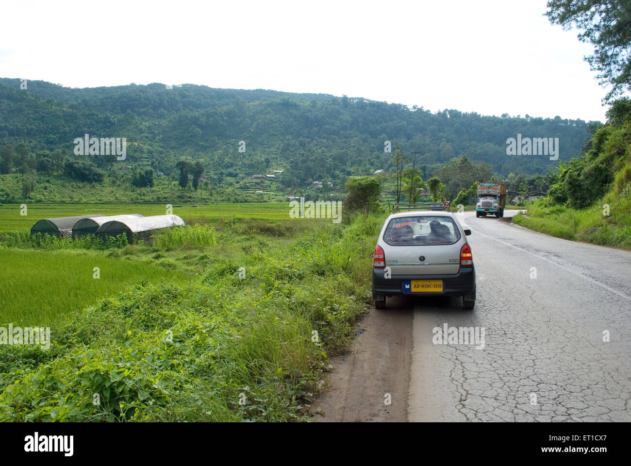 Vehicles on road ; Guwhati ; Assam ; India - Stock Image