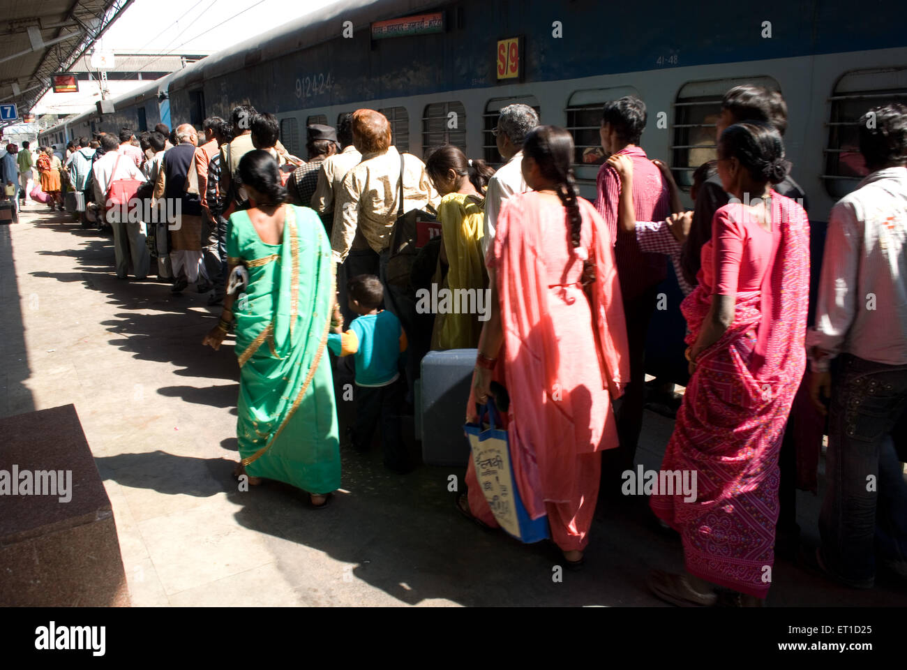 Travellers in queue to board a train on railway station ; Ahmedabad ; Gujarat ; India Stock Photo